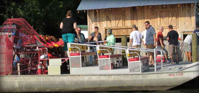 people on airboat swamp tour boat, airboat tours in spring